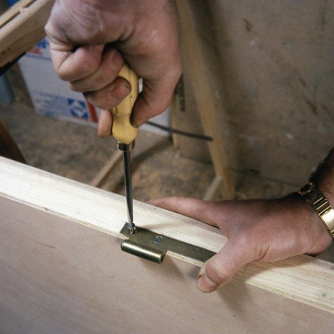 When you have fitted the brass hinges to the door edge, screw them tight and they should be vertically aligned.