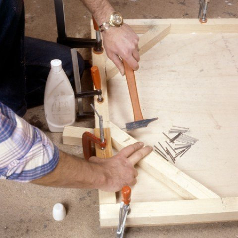 Nail the four reinforcement cleats into each corner of the frame
